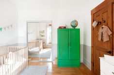 Baby Simone's room. The green cabinet was found at a flea market and painted by the couple.