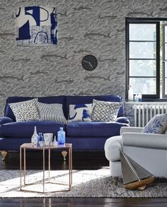 Blue and white is a classic colour combination that's perfect for a nautical scheme. Whale motif wallpaper adds a quirky twist to this timeless look.