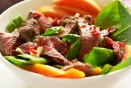 Griddled Beef, spinach and papaya salad