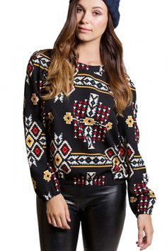 Christina Black Price: € 29.00  Black and red printed easy to wear long sleeve top