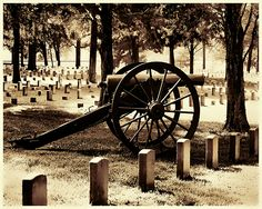 A Civil War cannon stands still and silent in the Stonesriver Battlefield cemetery in Murfreesboro, Tennessee