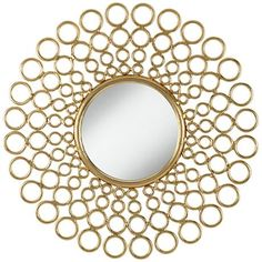 Differently sized rings surround an inner round mirror creating striking dimension in depth in this sunburst wall mirror.