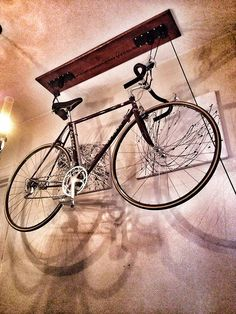 annalisala:  Creative bike storage doubles as art in my house.