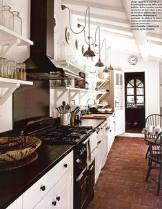 White rustic kitchen. Love the floors.