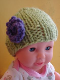 Baby Doll Hats by Jennifer Dickerson A simple, pretty hat for a doll.check out my Cotton Candy Toddler Hat so yo. Knitting Dolls Clothes, Baby Doll Clothes, Baby Hats Knitting, Doll Clothes Patterns, Free Knitting, Baby Dolls, Charity Knitting, Sewing Dolls, Free Knitted Flower Patterns