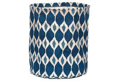 "Jai Ikat Canvas Basket, Navy on OKL ($14 v. $22 retail) Made of: cotton canvas 12"" x 13"" Color: blue/white/teal  ""Storage doesn't have to be boring. This playful ikat canvas basket comes complete with a water-resistant lining that wipes clean. Use it as a wastebasket or to store toys, blankets, or crafts.  Rockflowerpaper artists love transforming proprietary art and design created in their San Anselmo, CA, studio into sophisticated, strong, and functional products."""