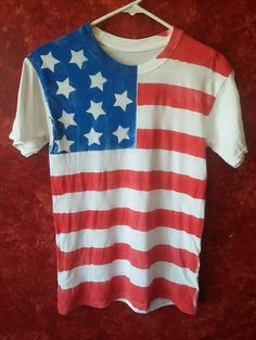 Check out this item in my Etsy shop https://www.etsy.com/listing/293781417/spray-painted-american-flag-t-shirt-made