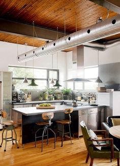 This industrial style home-studio of an artist is a warehouse conversion offering a wealth of refreshing ideas and natural light, located in Montreal, Quebec. Loft Kitchen, Kitchen Interior, New Kitchen, Kitchen Design, Kitchen Decor, Industrial House, Industrial Style, Kitchen Industrial, Industrial Bedroom