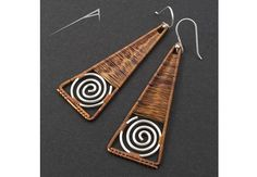 copper and silver spiral geometric earrings