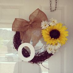New wreath for the house. Burlap, sunflower, & daisies :) DIY