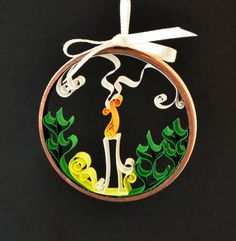 This design is based on one I made for my sister. I have several in my shop, each a bit different.  Christmas ornament candle with holly quilled paper by Whomsoever