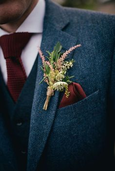 Buttonhole attached to grooms jacket for an Autumn wedding