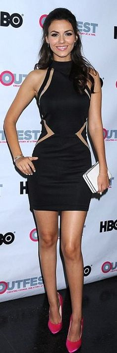Who made Victoria Justice's pink pumps, white clutch handbag, and black mesh dress?