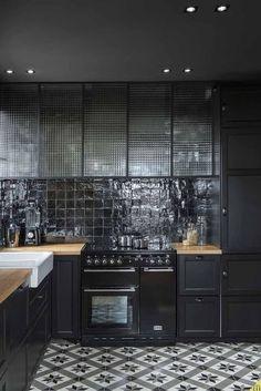 Kitchen. Black cabinets, wooden counter, white sink