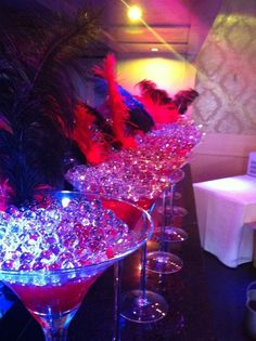 Martini centrepiece black and red feather James Bond party wedding