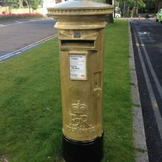 Royal Mail paints a postbox gold in Bradley Wiggins home town and creates stamps in honour of Team GB gold medalists