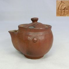Bizen ware -   AGE : About 30 years ago.   MATERIAL : Pottery of Bizen-yaki. Bizen-yaki is pottery and stoneware made in Bizen area, Japan. Bizen area is current Okayama Prefecture. That history is very old. The origin is the 12 century. And Bizen is one of the Six Ancient Kilns. It does not rarely use the glaze. That is a natural glaze occurring by chance in a kiln. The texture of clay with natural glaze attract Japanese people. Sometimes, we represent it with a Wabi-Sabi. Okayama, 12th Century, Wabi Sabi, Thing 1 Thing 2, 30 Years, Stoneware, Glaze, Tea Pots, Pottery