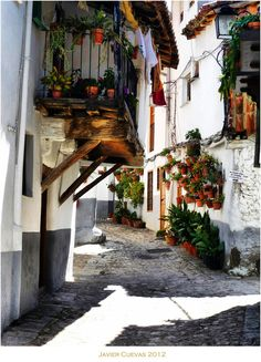 """Calles de Hervás by Javier Cuevas. Hervás, this charming village in the Gredos mountains, 150 miles west of Madrid, does not appear on most tourists' itinerary. The Jewish quarter of Hervás has been preserved intact, 70% of the people of Hervás lived in these streets, there is an old saying : """" En Hervás Judios los mas """" -"""