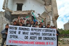 The anti-government Syrian town of Kafr Anbel sends a message to Boston after the marathon bombing. These 75 Iconic Photos Will Define The Century So Far. Everyone Needs To See This. Weekender, Boston Marathon Bomber, World Pay, Where Is The Love, Iconic Photos, Faith In Humanity, My Heart Is Breaking, Countries Of The World, 21st Century