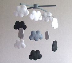 Cloud Mobile, Black and white baby mobile, Grey clouds mobile, Rain cloud mobile, Monochrome mobile, Grey and white mobile, Contrast Mobile Shipping Time: Ready-to-ship This wonderful mobile with felt clouds is perfect for babys nursery or new playroom. The high contrast black and white designs are eye contrasting and will coordinate with any color scheme. A beautiful addition to any room - childrens, living area or bedroom. The perfect baby shower or new baby gift! This handmade created ...