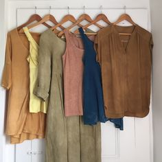 My natural dye wardrobe. Left to right: Onion skins on cotton; Queen Anne's lace on silk; sumac leaves with iron modifier on linen; avocado skins and pits on linen; indigo on cotton; coffee grounds on silk. Plant-based dyes are sustainable fashion magic. Photo and dyes by Katrina Rodabaugh.