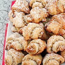 Rugelach Cookies Recipe Desserts, Afternoon Tea with all-purpose flour, salt, cream cheese, unsalted butter, vanilla extract, egg yolks, confectioners sugar, walnuts, melted butter, honey, granulated sugar, vanilla extract