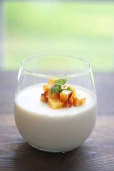 Panna Cotta with Fresh Summer Peaches soaked in Grand Marnier. The easiest yet most elegant dessert you've ever made!