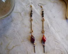 Mismatched Indian Glass, Steel Bead and Brass Barbell Earrings by cherokeedancing. Explore more products on http://cherokeedancing.etsy.com