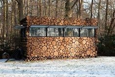 I love the way the windows close to create a total wood pile vibe.