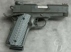Beautiful handgun...Rock Island Armory's Latest .45,Tactical II-The Tactical II is an all-steel 1911 handgun with a dark parkerized finish, and this particular one is an Officer's Model. Myself along with many others believe it is the ideal size for concealed carry in the 1911 format.