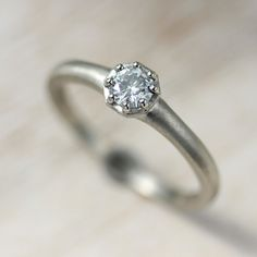Octagon Vintage Inspired Modern Engagement Ring. Handmade low-profile ring is eco-friendly, pictured in 14k White Gold with a prong-set Moissanite.