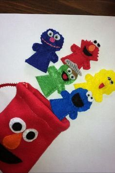 Hand sewn set of 5 finger puppets featuring Elmo, Big Bird, Oscar the Grouch, Grover, and Cookie Monster. Coordinating felt Elmo drawstring
