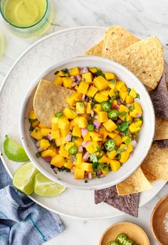 Mango Salsa Change up your salsa game with this sweet spicy & fun mango salsa recipe! Served with tortilla chips its the perfect easy appetizer for summer parties. Alternatively top it onto grilled chicken fish tacos or nachos! Mango Salsa Recipes, Spicy Salsa, Tortillas, Appetizers For Party, Appetizer Recipes, Appetizer Ideas, Vegan Appetizers, Nachos, Snacks Saludables