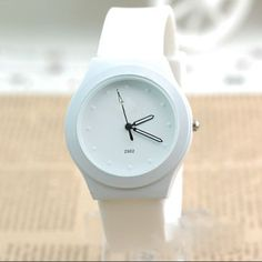 Fashionable women's analogue silicone watch. White band with face available in white, pink and green. *BEST PRICES *PLUS FREE DELIVERY