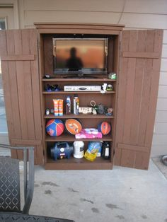 Outdoor Storage Cabinet. I'll build it shorter and wider, for the cooking baskets and with hooks to hang the  barbeque tools