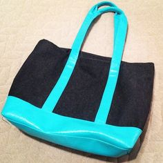 """Tote Bag Cute little denim tote bag! From Bath & Body Works. Bottom and straps are a pretty light blue. Rainbow striped interior. Inside contains three pockets including one with a zipper. Height 13"""". Width 18 1/2"""". Gently used but still in great condition Bags Totes"""