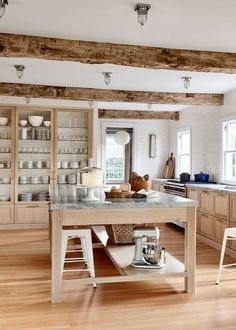 a classic kitchen in raw woods and white subway tile | pilar guzman house tour via coco kelley