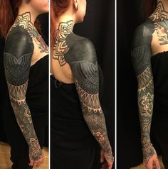 Breathtaking tribal inspired sleeve tattoo. Inked in grayscale, the sleeve tattoo is truly stunning on its own.  You can see that it starts from a floral design to a fully inked tribal shape which goes down to lighter tones as the tattoo approaches the wrists.