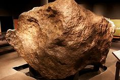 """The """"Ahnighito"""" fragment fell to Earth nearly 10,000 years ago. The iron masses were known to Inuit as Ahnighito (the Tent), weighing 31 metric tons (31 long tons; 34 short tons); the Woman, weighing 3 metric tons (3.0 long tons; 3.3 short tons); and the Dog, weighing 400 kilograms (880 lb).[2] For centuries, Inuit living near the meteorites used them as a source of metal for tools and harpoons.[3][4] The Inuit would work the metal using cold forging--that is by stamping and hammering it."""