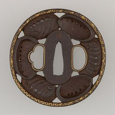 Sword Guard (Tsuba) Date: 19th century Culture: Japanese Medium: Iron, gold, copper