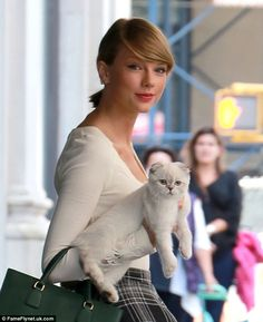 Feline fine: The 24-year-old first introduced Olivia to the world in June, and has since b...