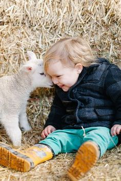 """Little lamb whispers to the child:  """"Do 'ewe' know where my Mom has gone to?  She was here in the barn a moment ago!"""""""