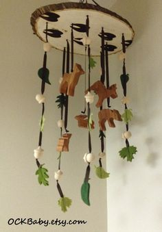 BUCKS, TRACKS & RUBS™ Hardwood Baby Mobile, Nursery Decor, Deer Hunting Nursery by OCKBaby on Etsy https://www.etsy.com/listing/220872940/bucks-tracks-rubs-hardwood-baby-mobile