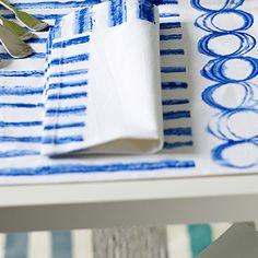 The stunning Jinshi table top textiles with bright cobalt painterly stripes
