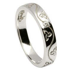 Omg!! This is sooo the one! Shanore Narrow Engraved Trinity Knot Wedding Ring. Single diamond, made in Ireland. Wow <3