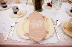 Table Setting, antique plates and flatware, cloth napkin, layered fabric table cloth..