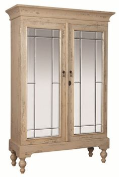 Mirrored Armoire has an aged and distressed cream finish and clear beveled mirror door fronts.