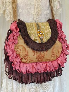 ok I know its not crochet, but my mind thinks in crochet... I see a double edged long ruffle around the purses I was making... hmmm