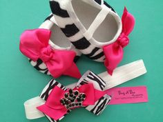 """The Must have gift for ANY baby girl!!  Zebra Crib Shoes with Hot pink Satin Bow and coordinating zebra and hot pink bow with black crown centerpiece. Bow is securely attached to an aligator clip, and attached to a white stretchy interchangable headband, made to grown with your baby girl!!  Crib shoes measure 4"""" and fit apprx newborn-6mo"""