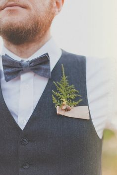 Forest Floor Boutonniere, $10 @ Ems Desert Rose  Delicate bits of fern, bark, moss and acorn combine to create a forest-inspired boutonniere, perfect for a woodsy, mountain wedding. This sweet boutonniere will preserve well, too, to serve as a momento of the big day.